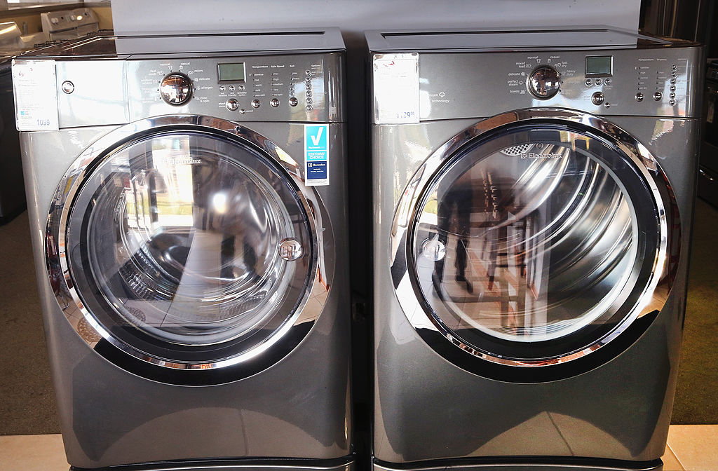 An Electrolux washer and dryer are offered for sale at an appliance store