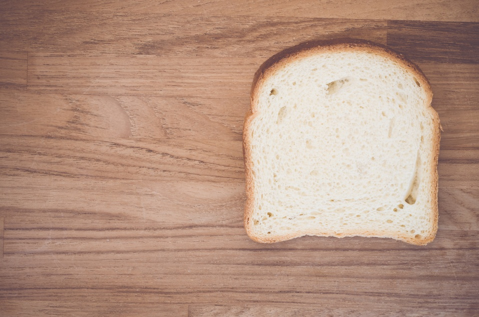 white bread slice on a natural wood backgrounds