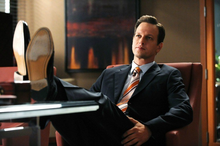 Josh Charles as Will Gardner in a suit sitting in an office chair with his feet up on The Good Wife