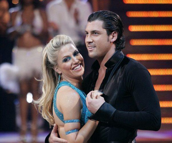 Willa Ford and Maksim dance together in front of judges and an audience.