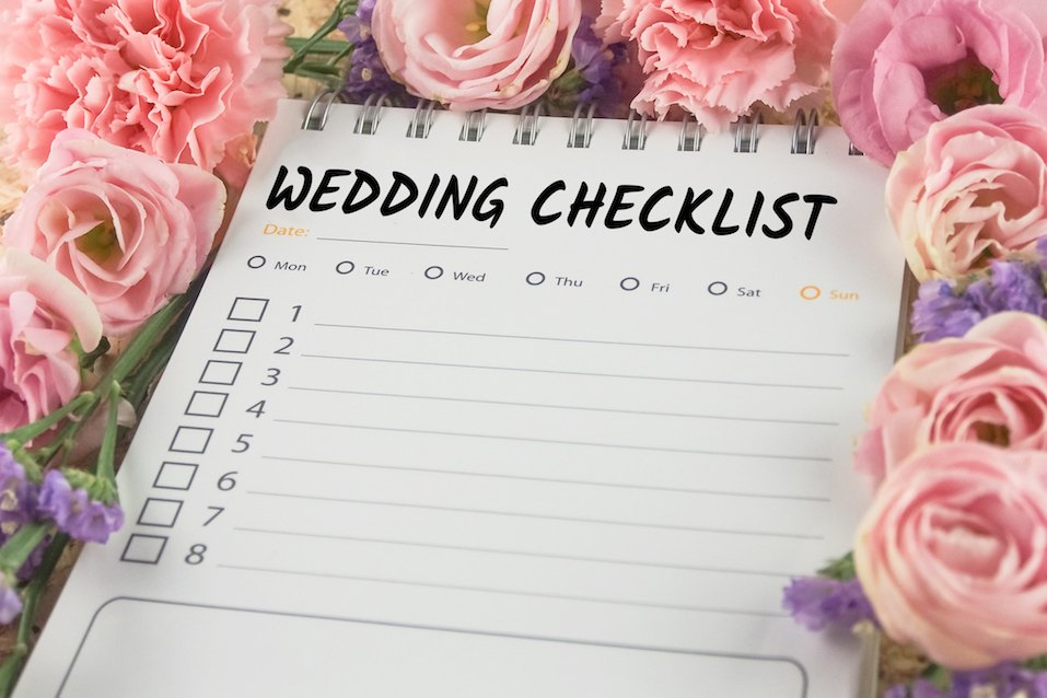 word wedding checklist note paper on pink flower background