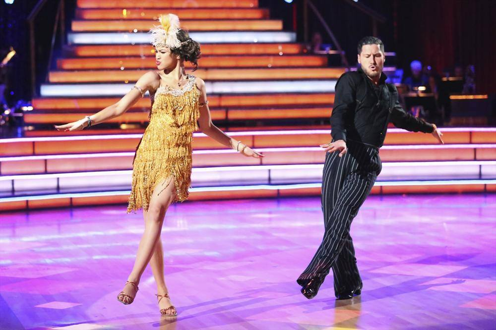 Zendaya Coleman wears a gold fringe dress as she dances next to Val Chmerkovskiy on 'Dancing With the Stars.'