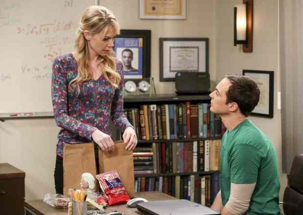 Ramona unpacks a lunch bag while looking at Sheldon in The Big Bang Theory Season 10 finale