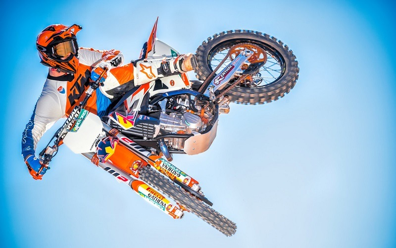 Biker in mid-air during jump on KTM SX-F
