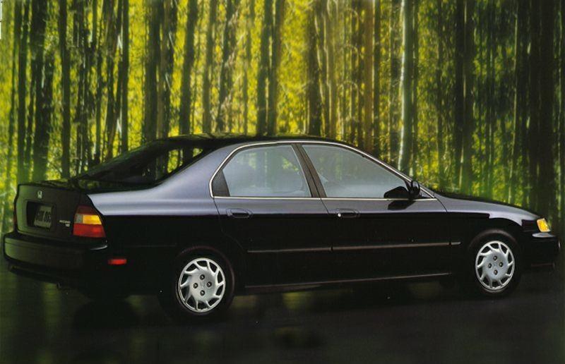 Rear three quarter view of black Honda Accord sedan from 1994 model year