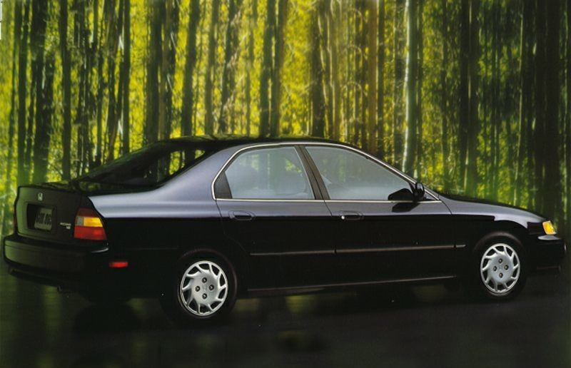 Rear three quarter view of black Honda Accord sedan from 1994 model year