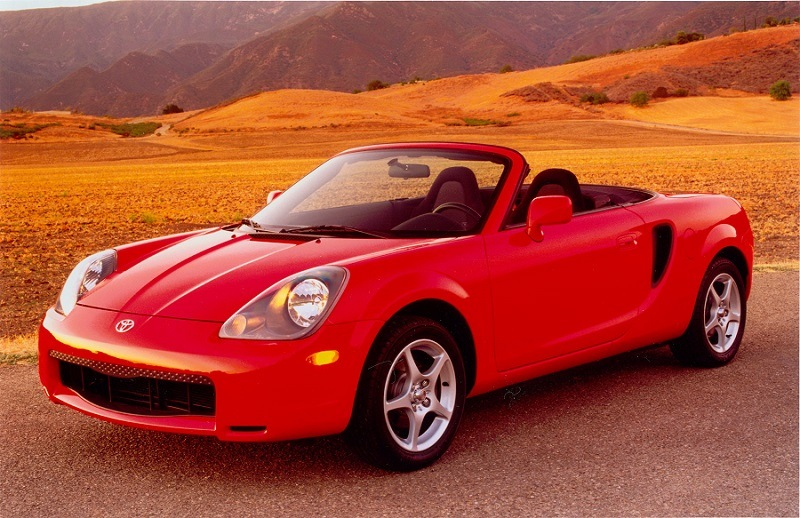 Red Toyota MR2 Spyder in country setting