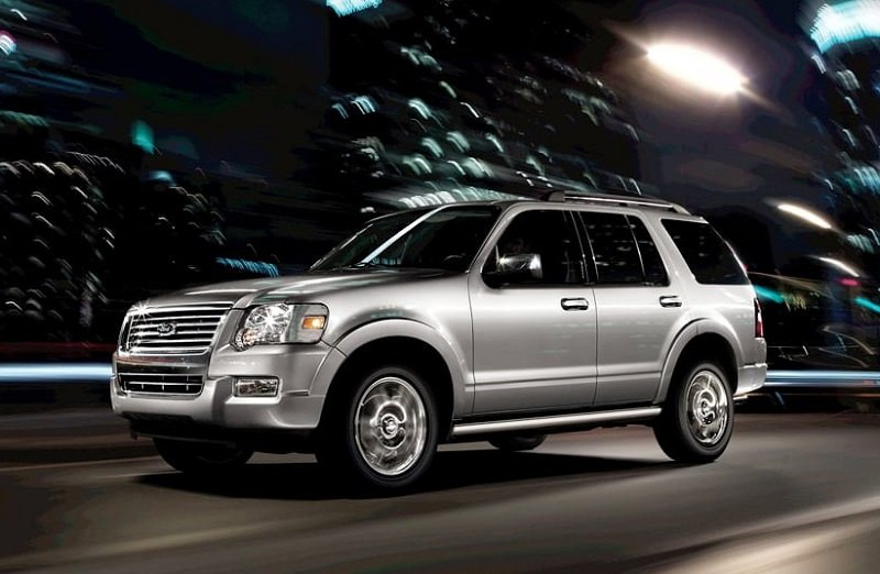 Shot of 2009 Ford Explorer driving on city streets at night