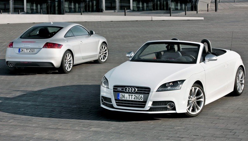 View of 2010 Audi TT Roadster with rear view of coupe model in background