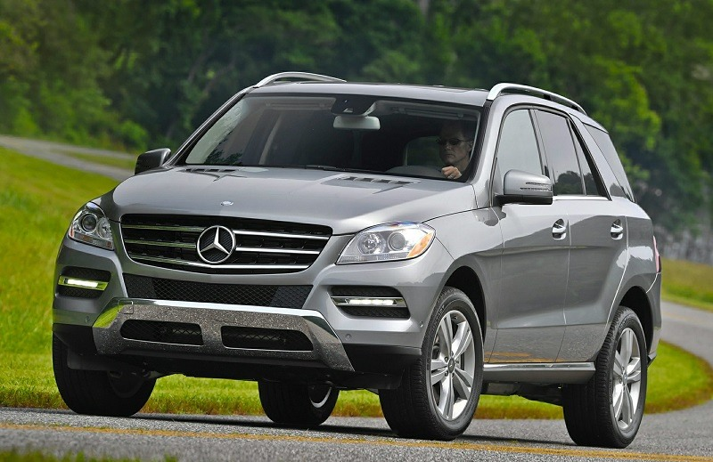 OEM shot of 2014 Mercedes M-Class SUV on country road