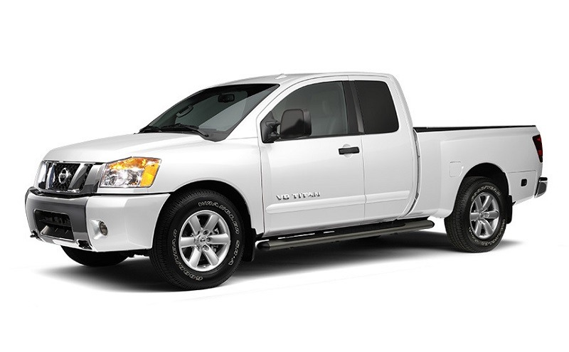 Studio shot of 2014 Nissan Titan Crew Cab pickup truck in white