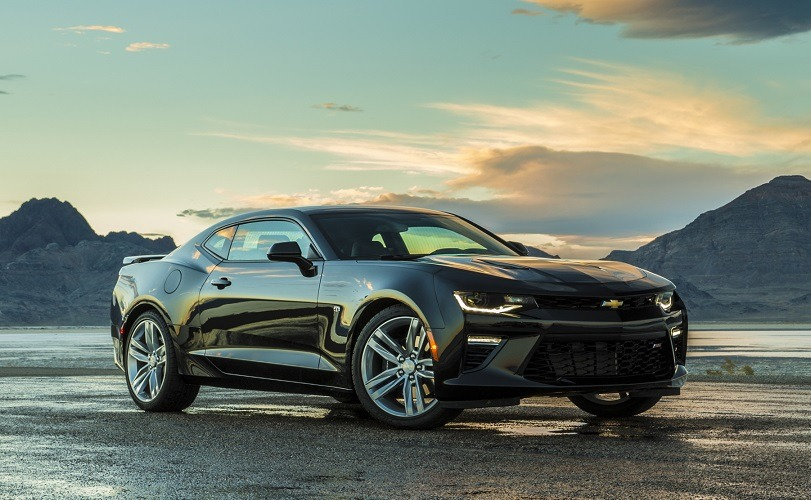 View of Chevy Camaro SS on scenic road at dusk