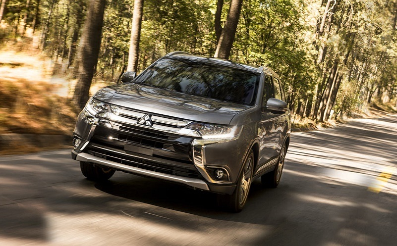 View of 2017 Mitsubishi Outlander driving through wooded area