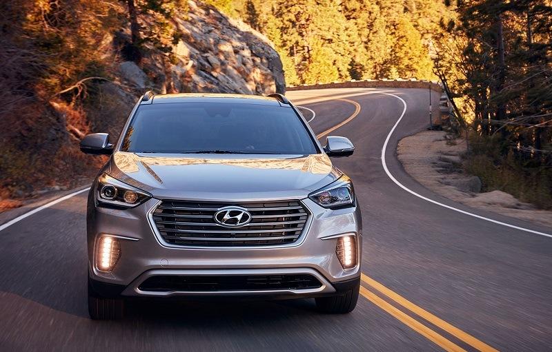 Shot of 2017 Hyundai Santa Fe driving on winding road