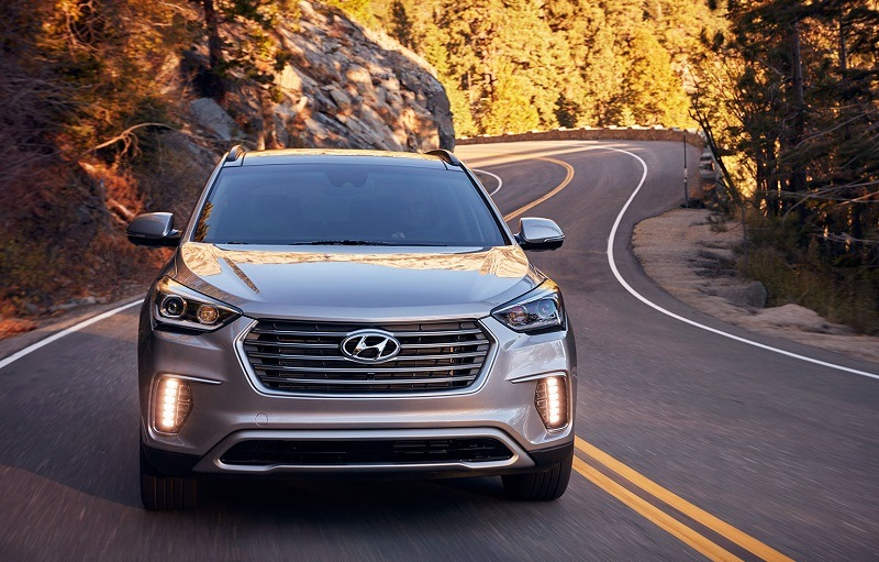 Shot of 2017 Hyundai Santa Fe driving on winding road