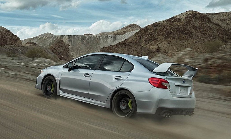View of 2018 Subaru WRX STI driving up a mountain