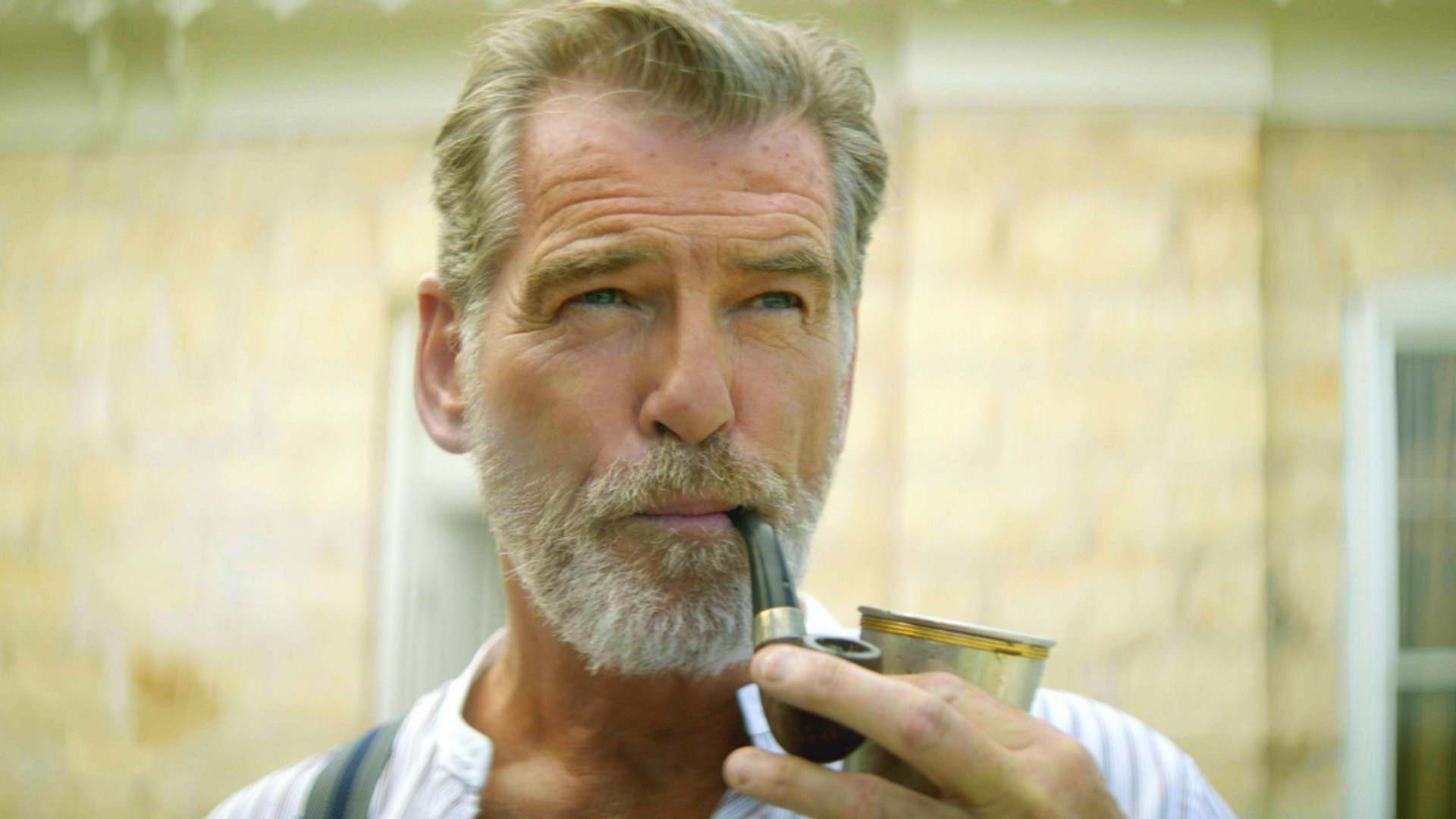 Pierce Brosnan smokes a pipe in The Son
