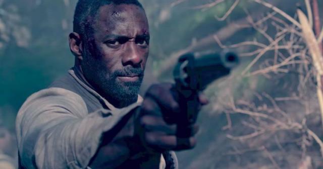 Idria Elba holds up a gun in The Dark Tower