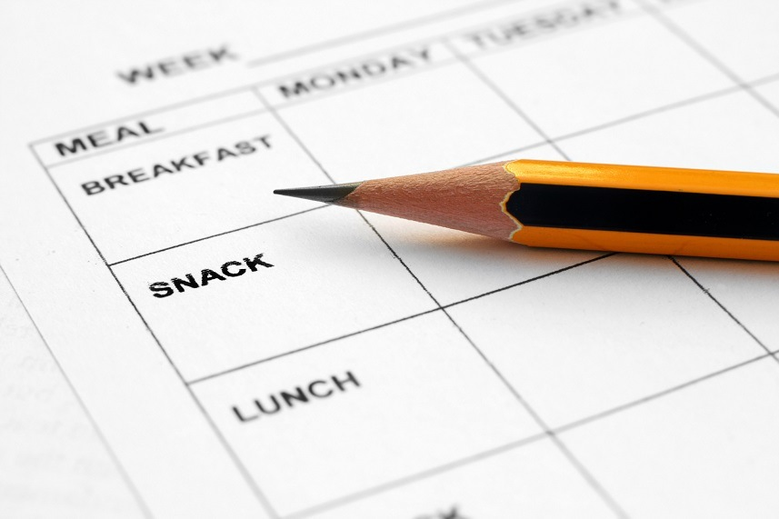 Pencil lying on a meal planner