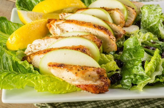 A chicken and lemon salad on a plate.