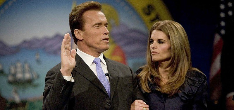 Arnold Schwarzenegger and Maria Shriver stand together as he is being sworn into office.