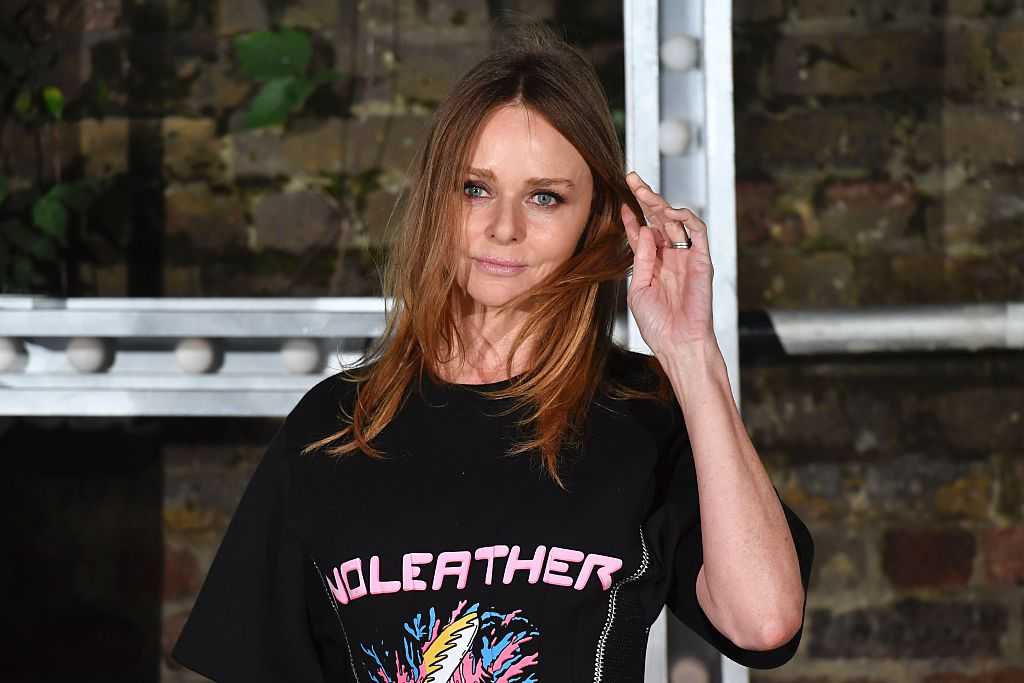 "Stella McCartney wears a shirt that reads, ""No leather."""