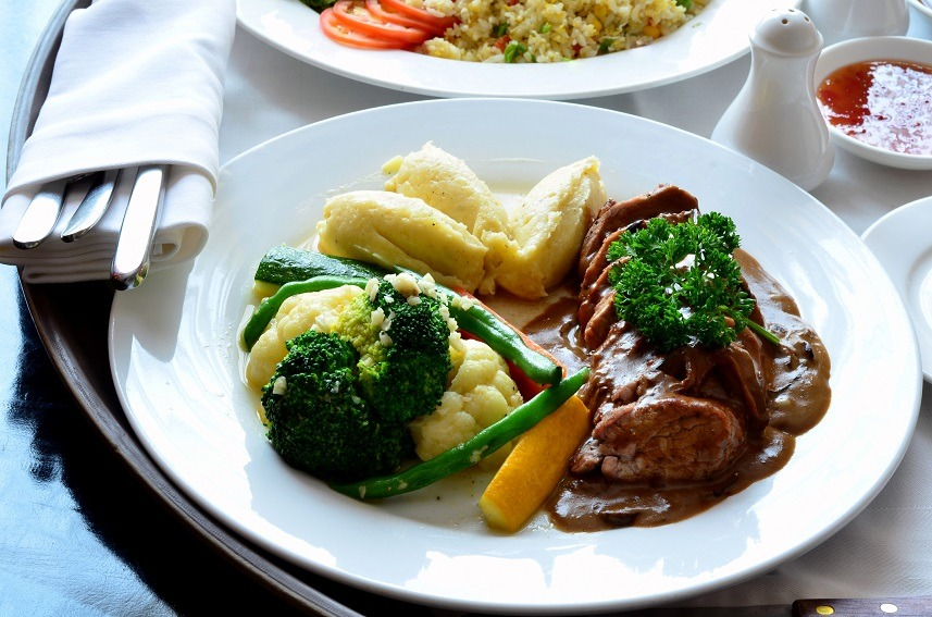 beef steak served with vegetables and potato