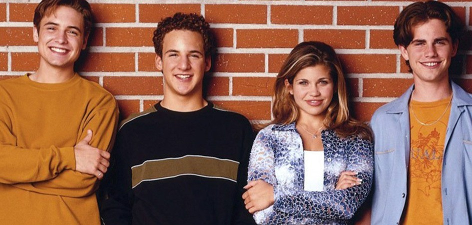 Eric, Cory, Topanga, and Shawn leaning against a brick wall