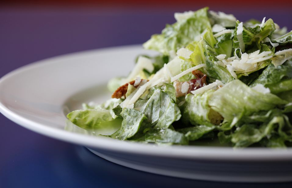 Caesar salad with homemade bacon.