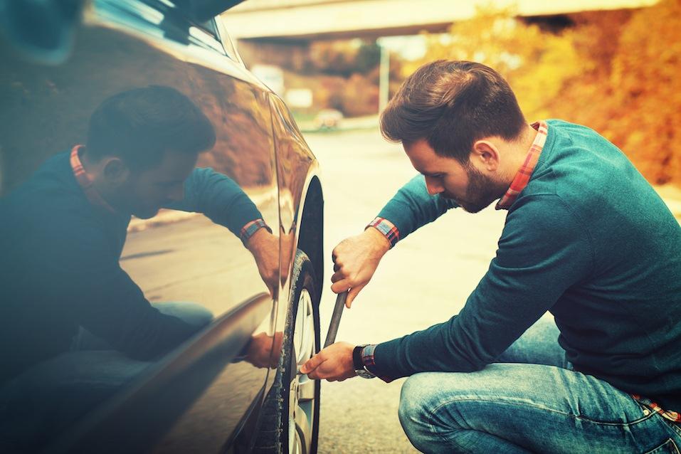 man fixing tire