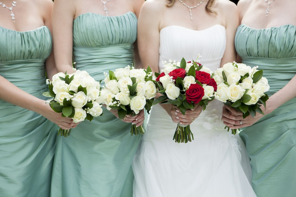 Close Up Of Bride And Bridesmaids Holding Flowers