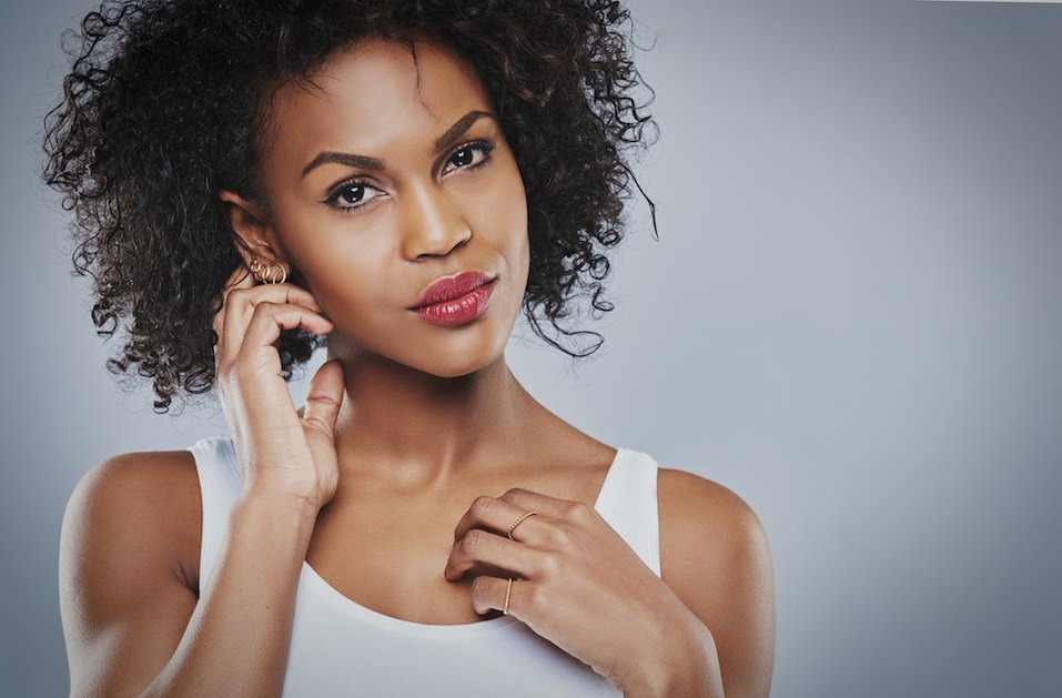 beautiful black woman with big curly hair in white top