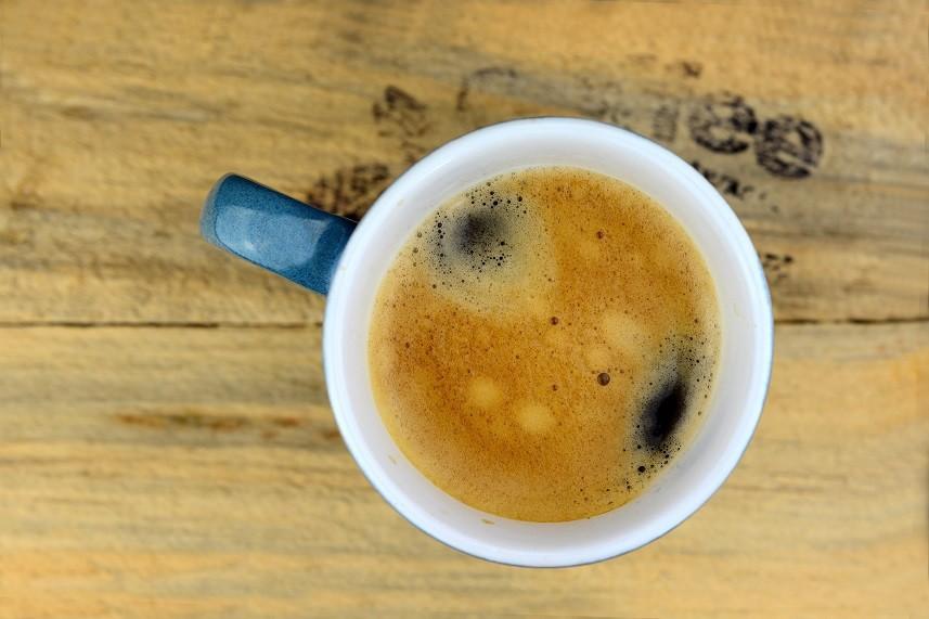 Coffee mug on old wood