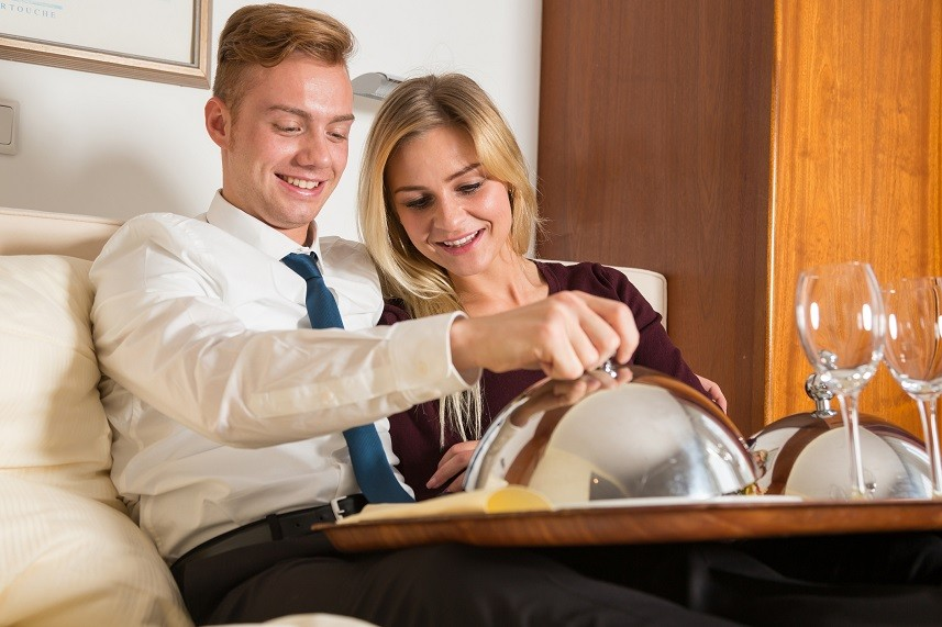 Couple with tray of room service food