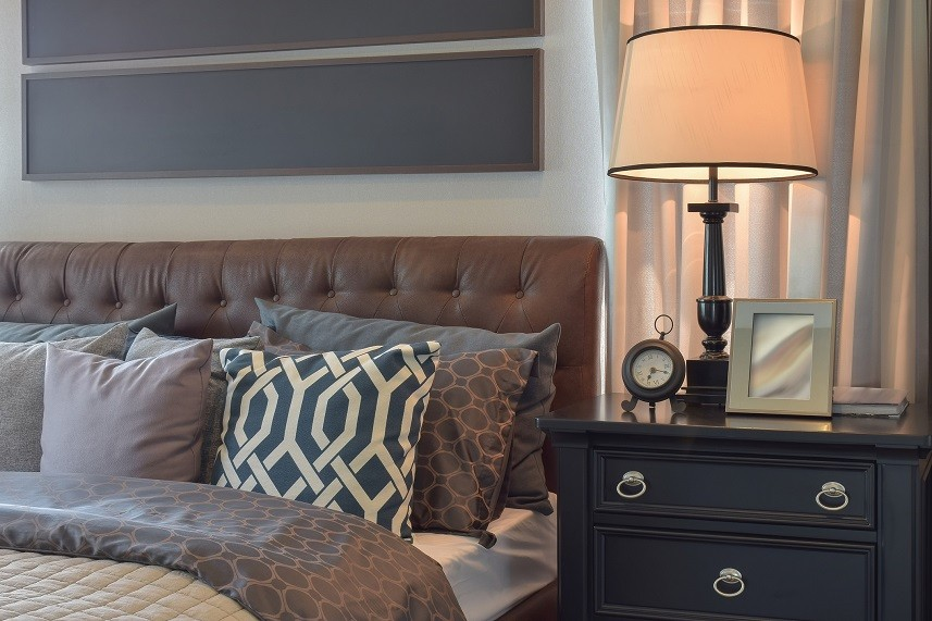 bedroom interior with pillows and reading lamp