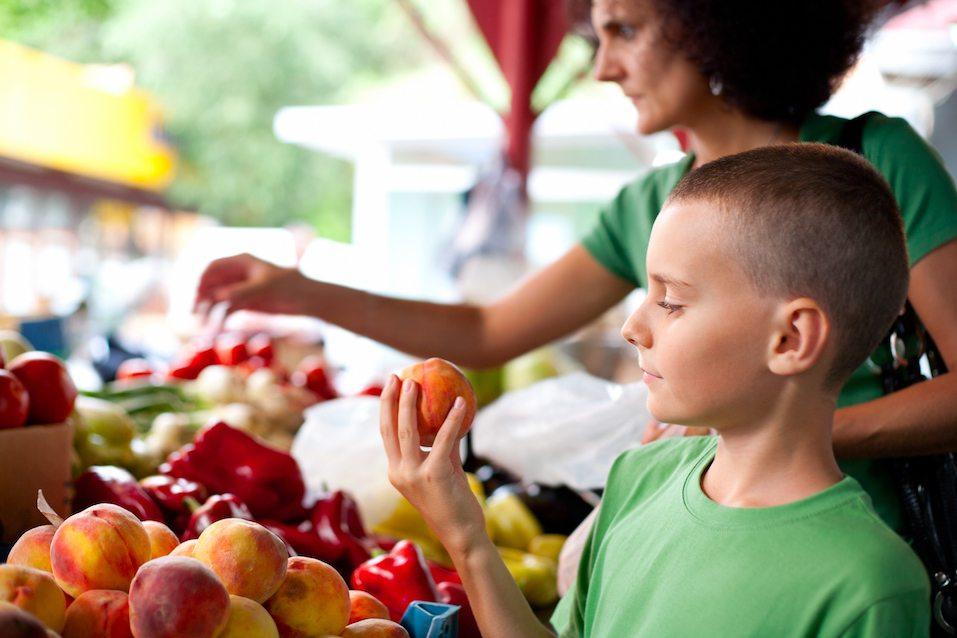 boy buying fruit