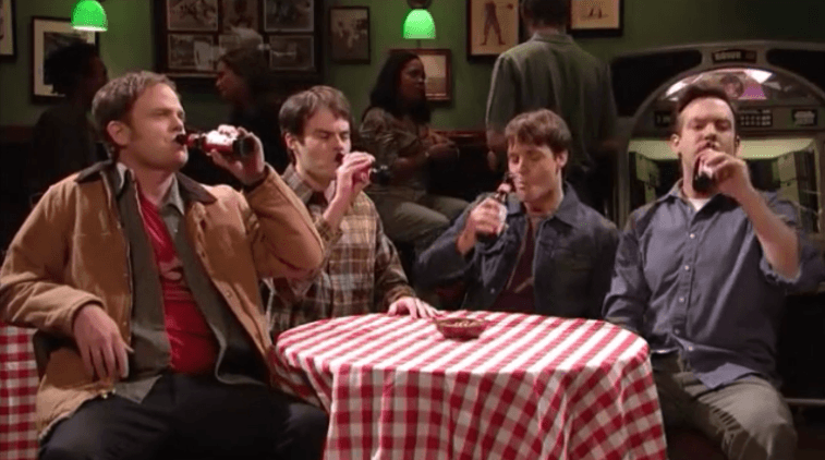 Rainn Wilson, Bill Hader, Will Forte, and Jason Sudeikis sit around a table with a checkered tablecloth.