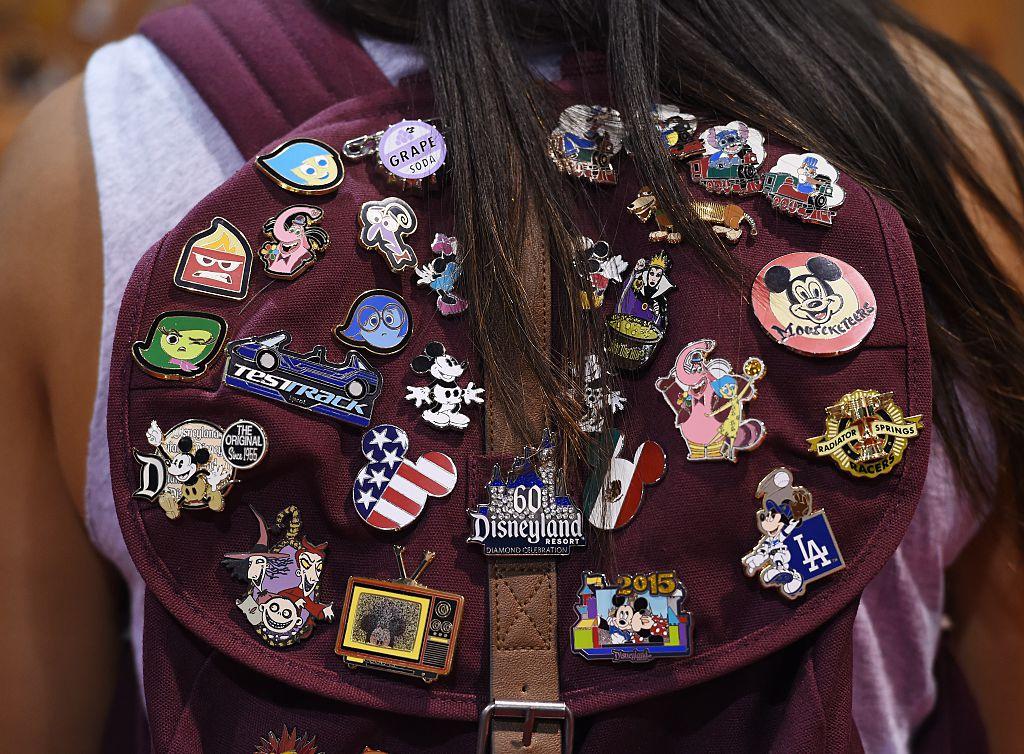 Disney pins on a fan's backpack