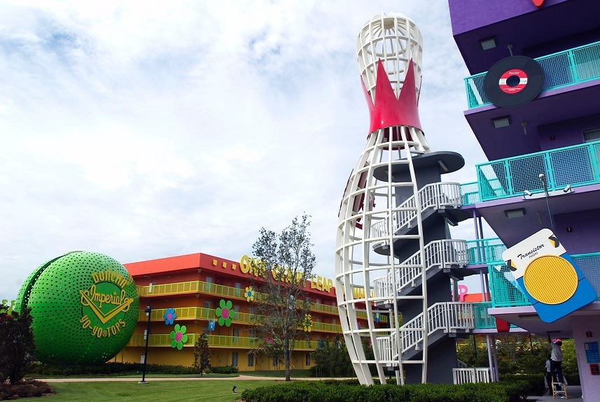 Disney workers adjust lights during a media preview of Disney's Pop Century Resort