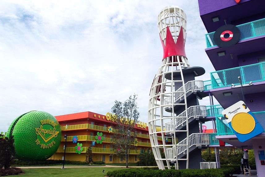 Disney workers adjust lights during a media preview of Disney's Pop Century Resort