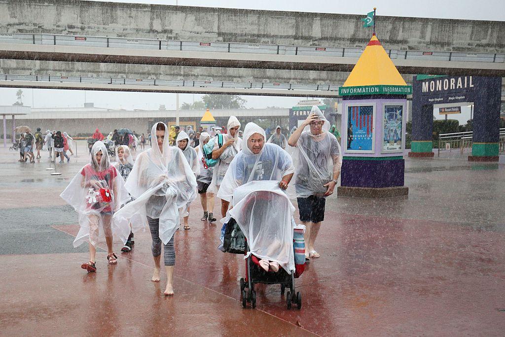 People leave Disney's Magic Kingdom theme park