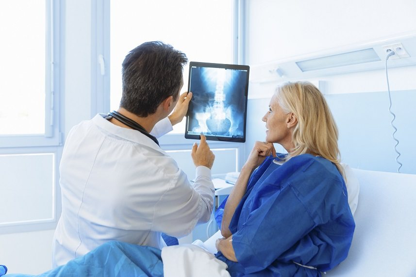 Doctor showing x-ray to a patient