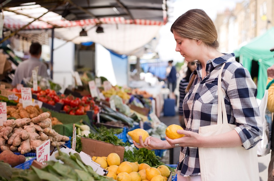 young woman at the market shopping