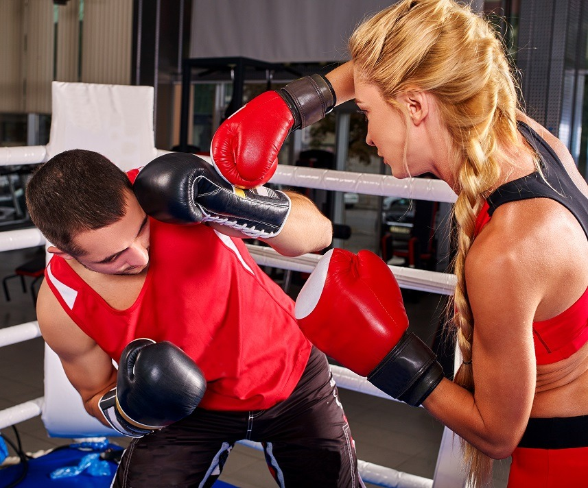 two people boxing in a gym
