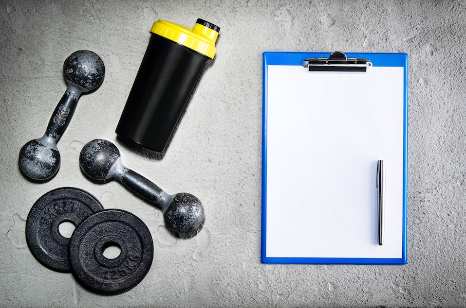 Fitness or bodybuilding background. Old iron dumbbells on conrete floor