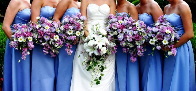 Wedding party holding bouquets.