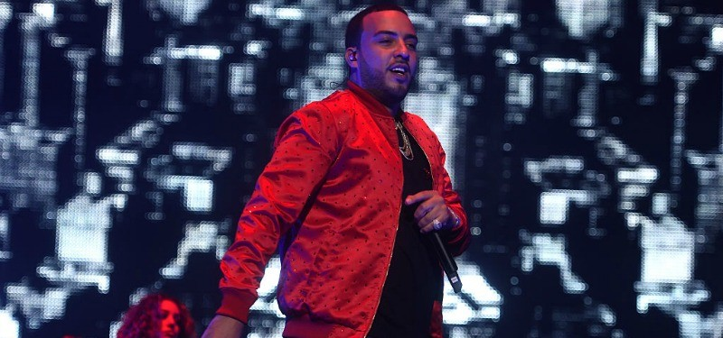 French Montana is wearing a red jacket and is on stage.