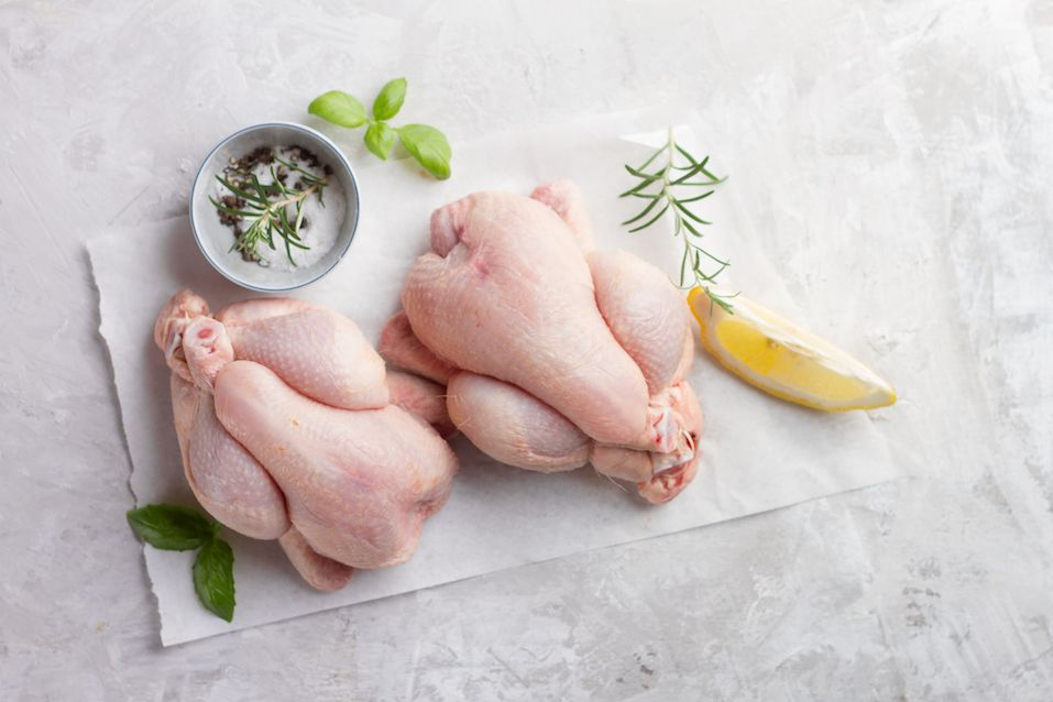 Fresh chicken with spices on vintage background