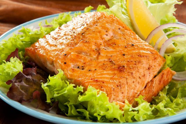 Fresh salmon on a pile of lettuce.