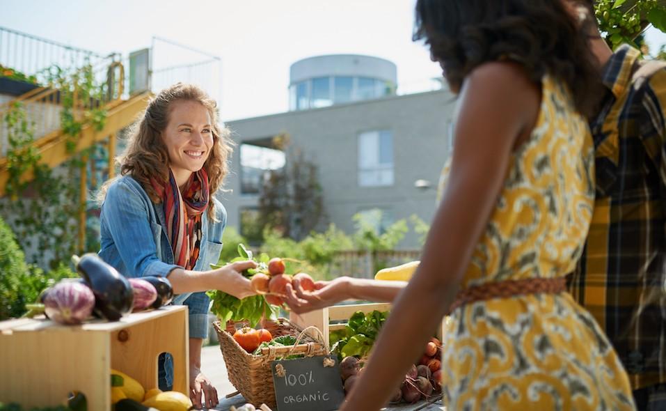 Female gardener selling organic crops